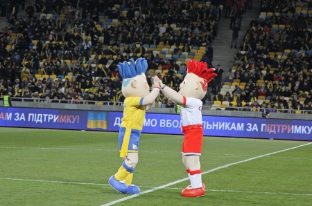 KYIV, UKRAINE - NOVEMBER 11, 2011: Slavek and Slavko, the UEFA Euro 2012 mascots playing during friendly game between Ukraine and Germany at NSK Olimpic stadium on November 11, 2011 in Kyiv, Ukraine