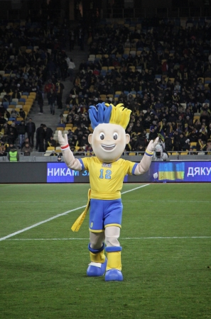 KYIV, UKRAINE - NOVEMBER 11, 2011: Slavko, the UEFA Euro 2012 official mascot plays during friendly game between Ukraine and Germany at NSK Olimpic stadium on November 11, 2011 in Kyiv, Ukraine