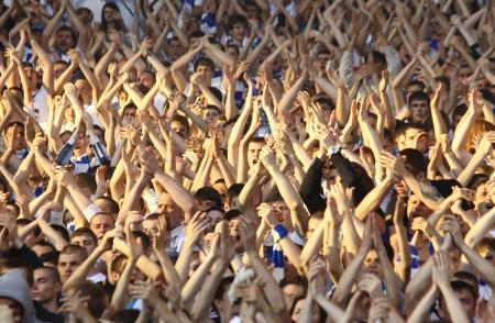 KYIV, UKRAINE - MAY 10, 2012: FC Dynamo Kyiv team supporters show their support during Ukraine Championship game against FC Tavriya at NSC Olimpiyskiy stadium on May 10, 2012 in Kyiv, Ukraine Editorial