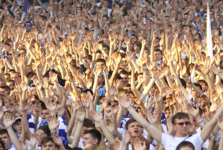 KYIV, UKRAINE - MAY 10, 2012: FC Dynamo Kyiv team supporters show their support during Ukraine Championship game against FC Tavriya at NSC Olimpiyskiy stadium on May 10, 2012 in Kyiv, Ukraine