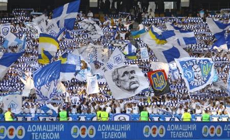 olimpiyskiy: KYIV, UKRAINE - MAY 10, 2012: FC Dynamo Kyiv team supporters show their support during Ukraine Championship game against FC Tavriya at NSC Olimpiyskiy stadium on May 10, 2012 in Kyiv, Ukraine Editorial