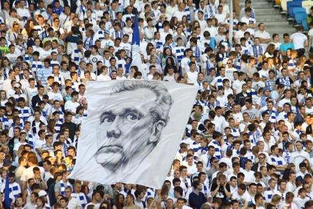 olimpiyskiy: KYIV, UKRAINE - MAY 10, 2012: FC Dynamo Kyiv team supporters show their support with big portrait of famous Valeriy Lobanovskyi during Ukraine Championship game against FC Tavriya at NSC Olimpiyskiy stadium on May 10, 2012 in Kyiv, Ukraine