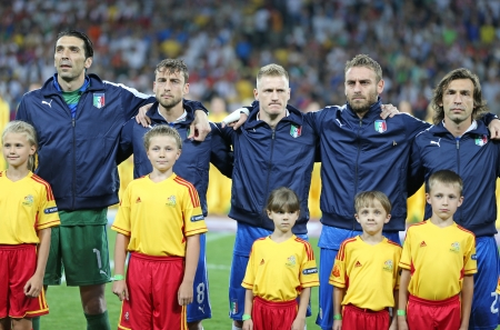 hymn: KYIV, UKRAINE - JUNE 24, 2012: Italy football team players and unidentified young footballers sing the national hymn before UEFA EURO 2012 game against England on June 24, 2012 in Kyiv, Ukraine