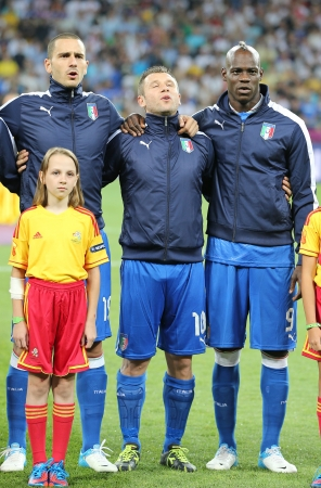 hymn: KYIV, UKRAINE - JUNE 24, 2012: Leonardo Bonucci (L), Antonio Cassano (C) and Mario Balotelli from Italy sing the national hymn before UEFA EURO 2012 game against England on June 24, 2012 in Kyiv, Ukraine