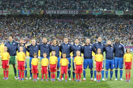 KYIV, UKRAINE - JUNE 24, 2012: Italy football team players and unidentified young footballers sing the national hymn before UEFA EURO 2012 game against England on June 24, 2012 in Kyiv, Ukraine