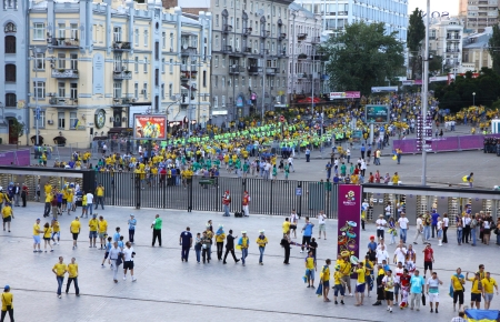 olimpiysky: KYIV, UKRAINE - JUNE 11, 2012: Soccer fans go to the Olympic stadium (NSC Olimpiysky) before UEFA EURO 2012 game between Ukraine and Sweden on June 11, 2012 in Kyiv, Ukraine Editorial