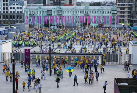 KYIV, UKRAINE - JUNE 11, 2012: Soccer fans go to the Olympic stadium (NSC Olimpiysky) before UEFA EURO 2012 game between Ukraine and Sweden on June 11, 2012 in Kyiv, Ukraine