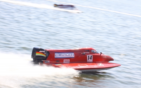 VYSHGOROD, UKRAINE - JULY 29, 2011: Jonas Andersson (SWE) of Team Sweden drives during Formula 1 H2O Powerboat World Championship GrandPrix on July 29, 2011 in Vyshgorod, Ukraine Stock Photo - 14514490