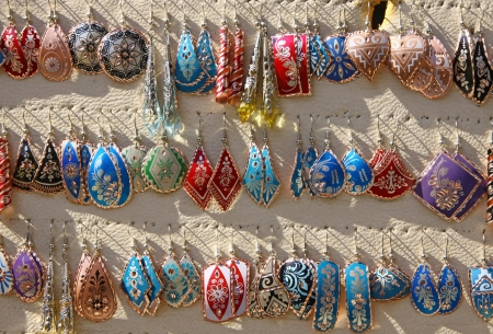 Colourful handmade asian-style earrings on a market stall in Istanbul, Turkey photo