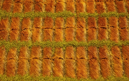 Close-up traditional Turkish baklava  sweet dessert made of thin pastry, nuts and honey  photo
