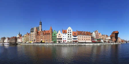 City of Gdansk  Danzig , Poland  Panoramic view of Old Town houses with reflections on Motlawa river waters photo