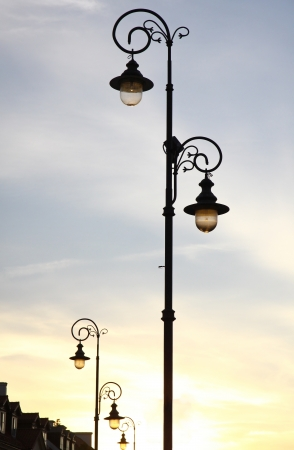 metall lamp: The retro-styled lamppost on the street of Warsaw, Poland Stock Photo