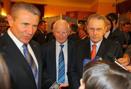 senior olympics: KYIV, UKRAINE - DECEMBER 17, 2010: President of Ukraine Olympic Committee Serhiy Bubka (L), President of EOC Patrick Joseph Hickey (C) and President of IOC Jacques Rogge (R) give an interview during Rogge official visit to Ukraine Editorial