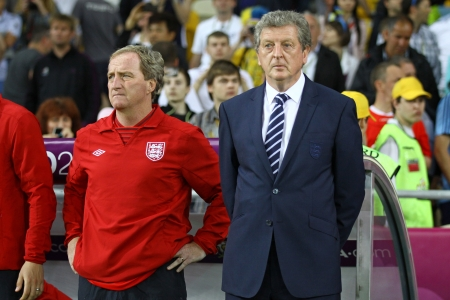 KYIV, UKRAINE - JUNE 15, 2012: Head coach of England national football team Roy Hodgson (R) and his assistant Ray Clemence look on during UEFA EURO 2012 game against Sweden on June 15, 2012 in Kyiv, Ukraine Stock Photo - 15486143