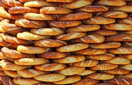 Traditional turkish crispy sesame bagels  simits  seen at a street vendor at Istanbul, Turkey Stock Photo - 15635830