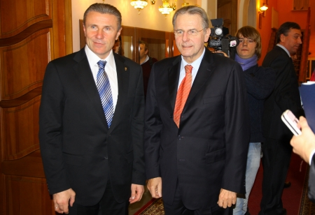 KYIV, UKRAINE - DECEMBER 17, 2010: President of National Olympic Committee of Ukraine Serhiy Bubka (L) and President of International Olympic Committee Jacques Rogge give an interview during Rogges official visit to Ukraine on December 17, 2010 in Kyiv