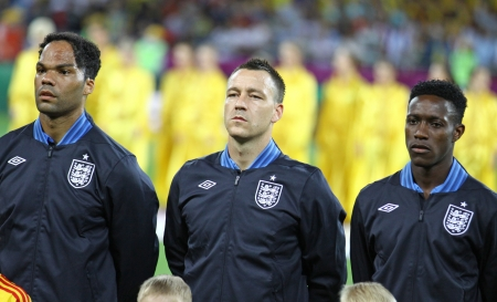 KYIV, UKRAINE - JUNE 15, 2012: Joleon Lescott (L), John Terry (C) and  Danny Welbeck of England listen the national anthem before UEFA EURO 2012 game against Sweden on June 15, 2012 in Kyiv, Ukraine Stock Photo - 16205964