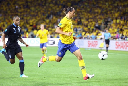 KYIV, UKRAINE - JUNE 15, 2012: Striker Zlatan Ibrahimovic of Sweden (in Yellow) control a ball during UEFA EURO 2012 game against England on June 15, 2012 in Kyiv, Ukraine