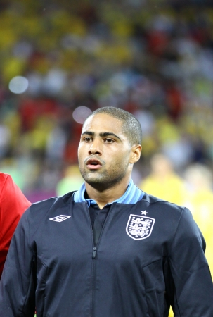 KYIV, UKRAINE - JUNE 15, 2012: Glen Johnson of England sings the national anthem before UEFA EURO 2012 game against Sweden on June 15, 2012 in Kyiv, Ukraine