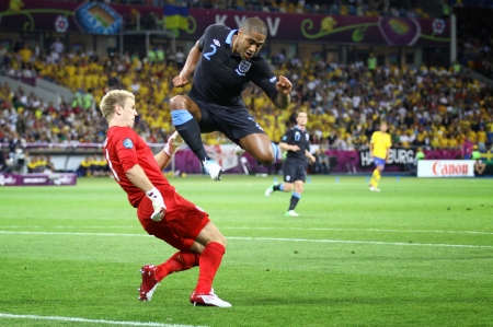 KYIV, UKRAINE - JUNE 15, 2012: Goalkeeper Joe Hart of Sweden (in red) fights for a ball with Glen Johnson of England during their UEFA EURO 2012 game on June 15, 2012 in Kyiv, Ukraine