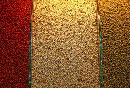 Piles of red, white and green pepper on a spice market in Istanbul, Turkey photo