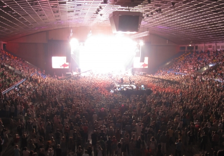 Numerous of cheering crowd in a concert hall during a rock concert