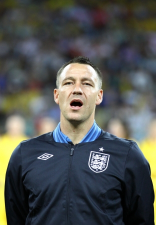 KYIV, UKRAINE - JUNE 15, 2012: John Terry of England sings the national anthem before UEFA EURO 2012 game against Sweden on June 15, 2012 in Kyiv, Ukraine Stock Photo - 16463034