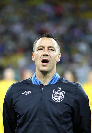 KYIV, UKRAINE - JUNE 15, 2012: John Terry of England sings the national anthem before UEFA EURO 2012 game against Sweden on June 15, 2012 in Kyiv, Ukraine Stock Photo - 16463034