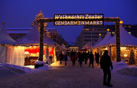 BERLIN, GERMANY - DECEMBER 28, 2010: People walking during Christmas market at Gendarmenmarkt square on December 28, 2010 in Berlin, Germany