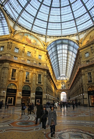 MILAN, ITALY - DECEMBER 31, 2010: People walking inside the Galleria Vittorio Emanuele - famous shopping gallery with elegant boutiques and fashion creator outlets on December 31, 2010 in Milan, Italy