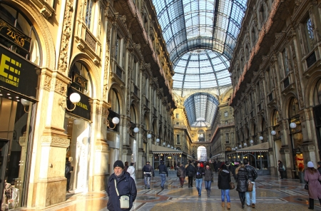 prada: MILAN, ITALY - DECEMBER 31, 2010: People walking inside the Galleria Vittorio Emanuele - famous shopping gallery with elegant boutiques and fashion creator outlets on December 31, 2010 in Milan, Italy