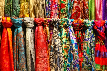 Rows of colourful silk scarfs hanging at a market stall in Istanbul, Turkey
