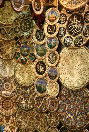 Decorative plates with drawings Istanbul landmarks at a market stall in Istanbul, Turkey