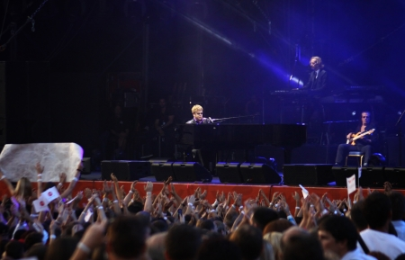 KYIV, UKRAINE - JUNE 30, 2012: Singer Sir Elton John performs onstage during charity Anti-AIDS concert at the Independence Square on June 30, 2012 in Kyiv, Ukraine