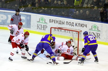 icehockey: KYIV, UKRAINE - NOVEMBER 11, 2012: Poland players (in white) defend their net during ice-hockey pre-olympic qualification game against Ukraine on November 11, 2012 in Kyiv, Ukraine