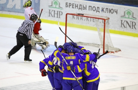 icehockey: KYIV, UKRAINE - NOVEMBER 11, 2012: Ukrainian players celebrate after scored against Poland during their ice-hockey pre-olympic qualification game on November 11, 2012 in Kyiv, Ukraine Editorial