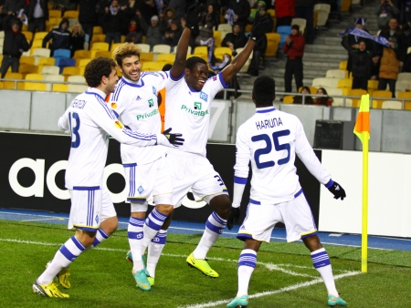 scored: KYIV, UKRAINE - FEBRUARY 14, 2013: FC Dynamo Kyiv players celebrate after Lukman Haruna (R, #25) scored against FC Girondins de Bordeaux during their UEFA Europa League game on February 14, 2013 in Kyiv, Ukraine