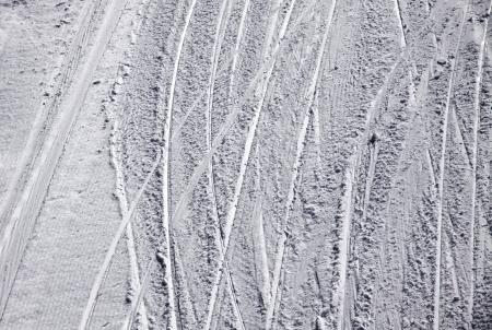 ski traces: Ski traces on a snow on the mountain slope