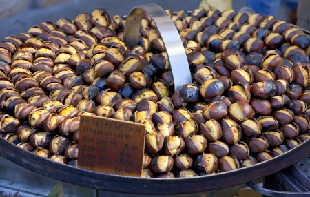 Roasting chestnuts on the grill by a street vendor in Rome, Italy photo