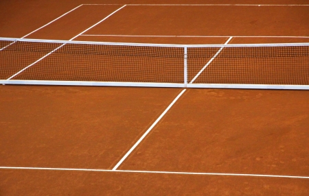 Empty clay tennis court during game time-out photo