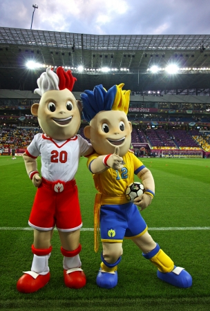 LVIV, UKRAINE - JUNE 9, 2012: Slavek and Slavko, the UEFA Euro 2012 mascots playing during the game between Germany and Portugal on June 9, 2012 in Lviv, Ukraine