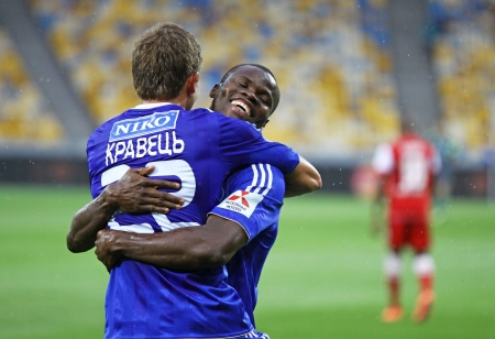 react: KYIV, UKRAINE - MAY 26, 2013: Artem Kravets (L) and Taye Taiwo of Dynamo Kyiv react after Kravets scores a goal during Ukraine Championship game against FC Metalurh Zaporizhya on May 26, 2013 in Kyiv, Ukraine