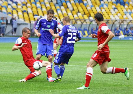 olimpiyskiy: KYIV, UKRAINE - MAY 26, 2013: FC Dynamo Kyiv and FC Metalurh Zaporizhya fight for a ball during their Ukraine Championship game at NSC Olimpiyskiy stadium on May 26, 2013 in Kyiv, Ukraine