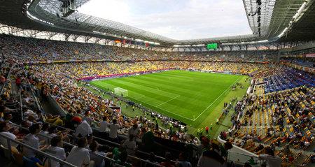 uefa: LVIV, UKRAINE - JUNE 9, 2012: Tribunes of Arena Lviv stadium during UEFA EURO 2012 game between Germany and Portugal on June 9, 2012 in Lviv, Ukraine Editorial