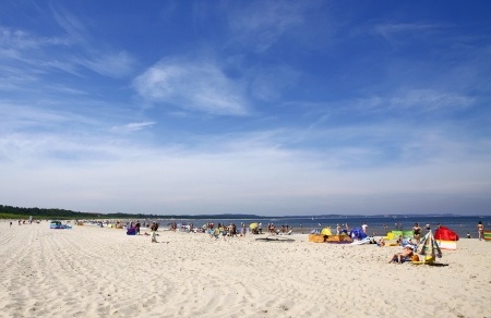 Crowded Baltic summer beach in Swinoujscie, Poland