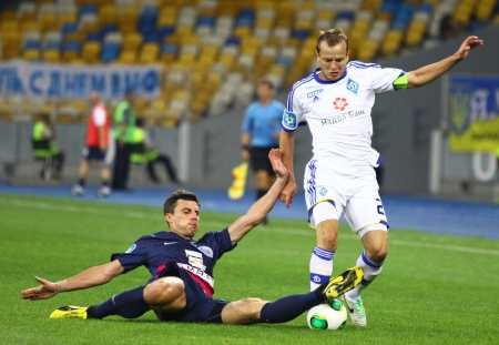 gusev: KYIV, UKRAINE - JULY 28, 2013  Oleg Gusev of Dynamo Kyiv  R  fights for a ball with Yevhen Neplyah of FC Sevastopol during their Ukraine Championship game on July 28, 2013 in Kyiv, Ukraine