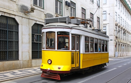 Typical yellow tram on the street of Lisbon, Portugal