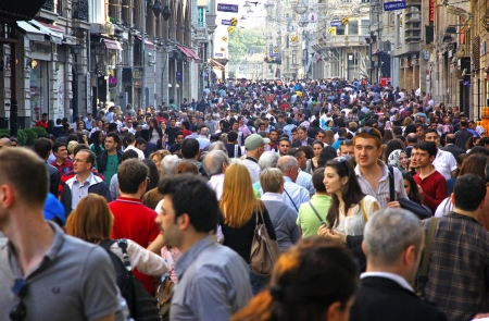 ISTANBUL, TURKEY - MAY 5, 2012  People walking on Istiklal Street on May 5, 2012 in Istanbul, Turkey  It is the most famous street in Istanbul, visited by nearly 3 million people in a single weekends day