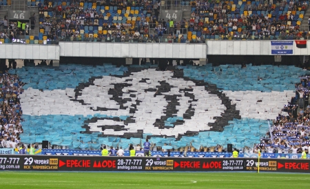 olimpiyskiy: KYIV, UKRAINE - APRIL 27, 2013  FC Dynamo Kyiv team supporters show their support during Ukraine Championship game against FC Dnipro at NSC Olimpiyskiy stadium on April 27, 2013 in Kyiv, Ukraine