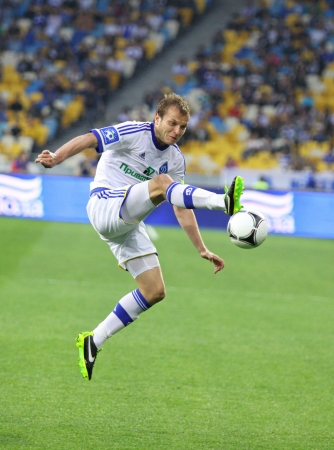 gusev: KYIV, UKRAINE - APRIL 27, 2013  Oleg Gusev of  FC Dynamo Kyiv controls a ball during Ukraine Championship game against FC Dnipro at NSC Olimpiyskiy stadium on April 27, 2013 in Kyiv, Ukraine